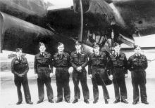 Colin Cole and his crew in front of a modified Lancaster plane